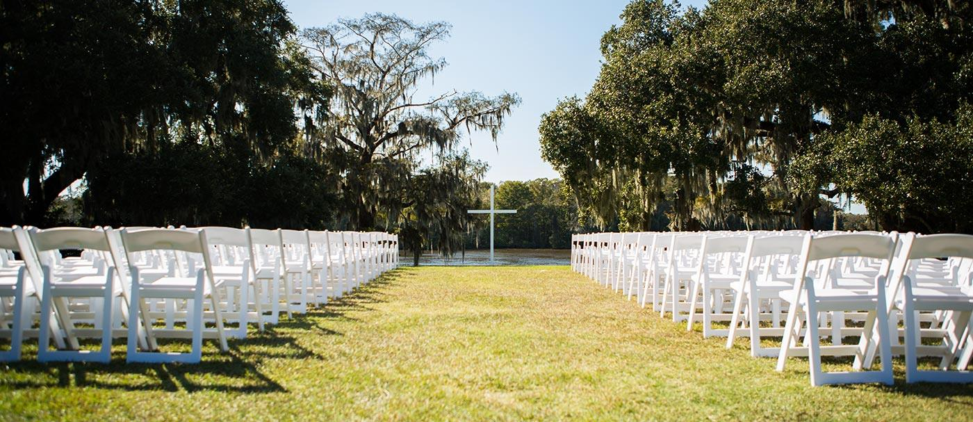 Wedding_river_white_chairs